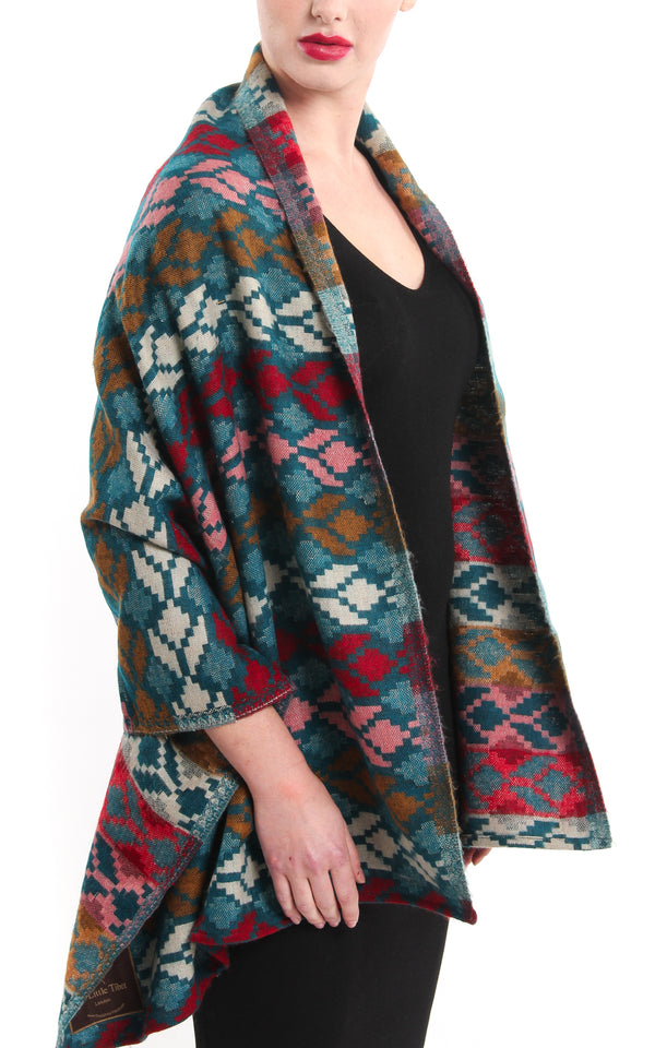 Geometric patterned overlay Himalayan reversible Tibet shawl draped around shoulders