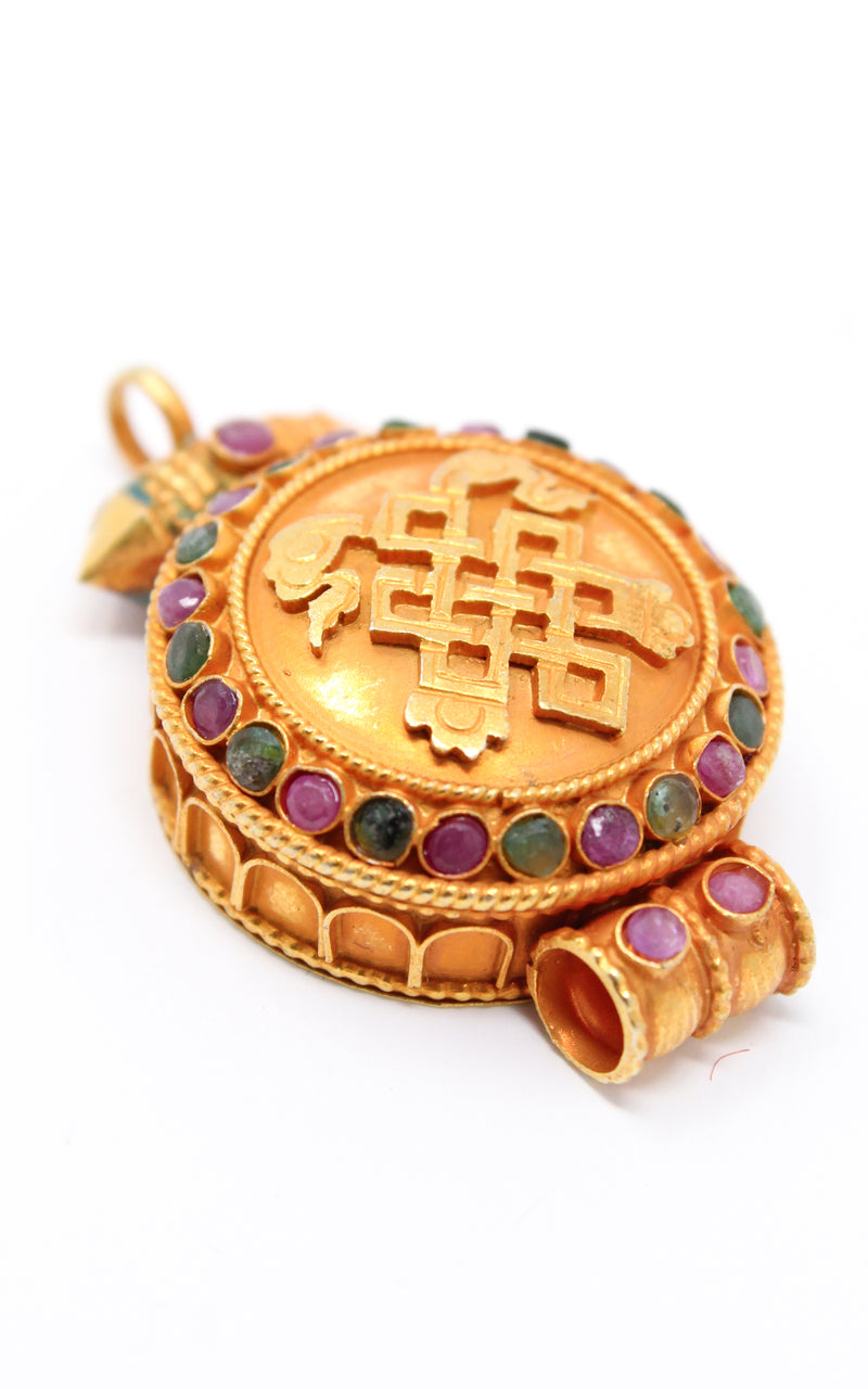 circular Gold Plated Endless Knot auspicious symbol Locket ruby emerald stones side close up