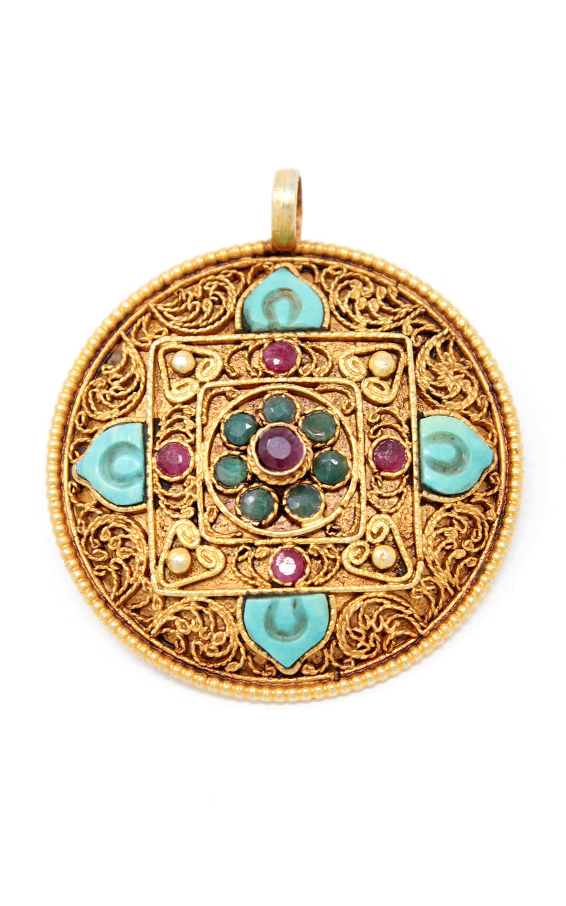 Circular Unique Gold Mandala Pendant Tibetan handmade jewellery close up