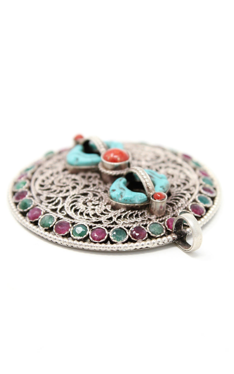 Silver Dorjee Pendant turquoise coral ruby emerald embellishment close up
