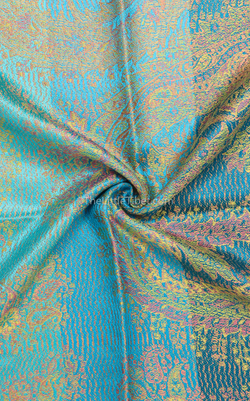 close up shot of luxurious print of 100% pure silk pashmina shawl - reversible teal blue