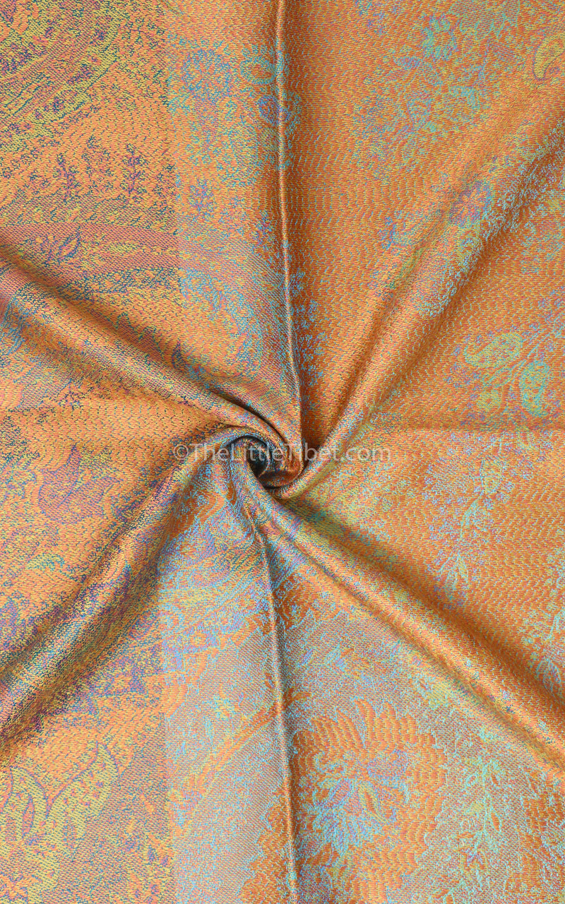 close up shot of luxurious print of 100% pure silk pashmina shawl - reversible gold