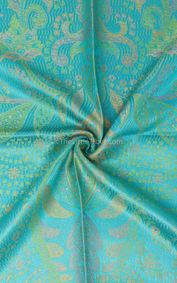 Close up of the Garden Green Silk Pashmina side with turquoise accents