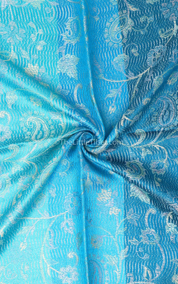 Close up of the Aqua Sea Blue Pure Silk Pashmina with silver paisley accents