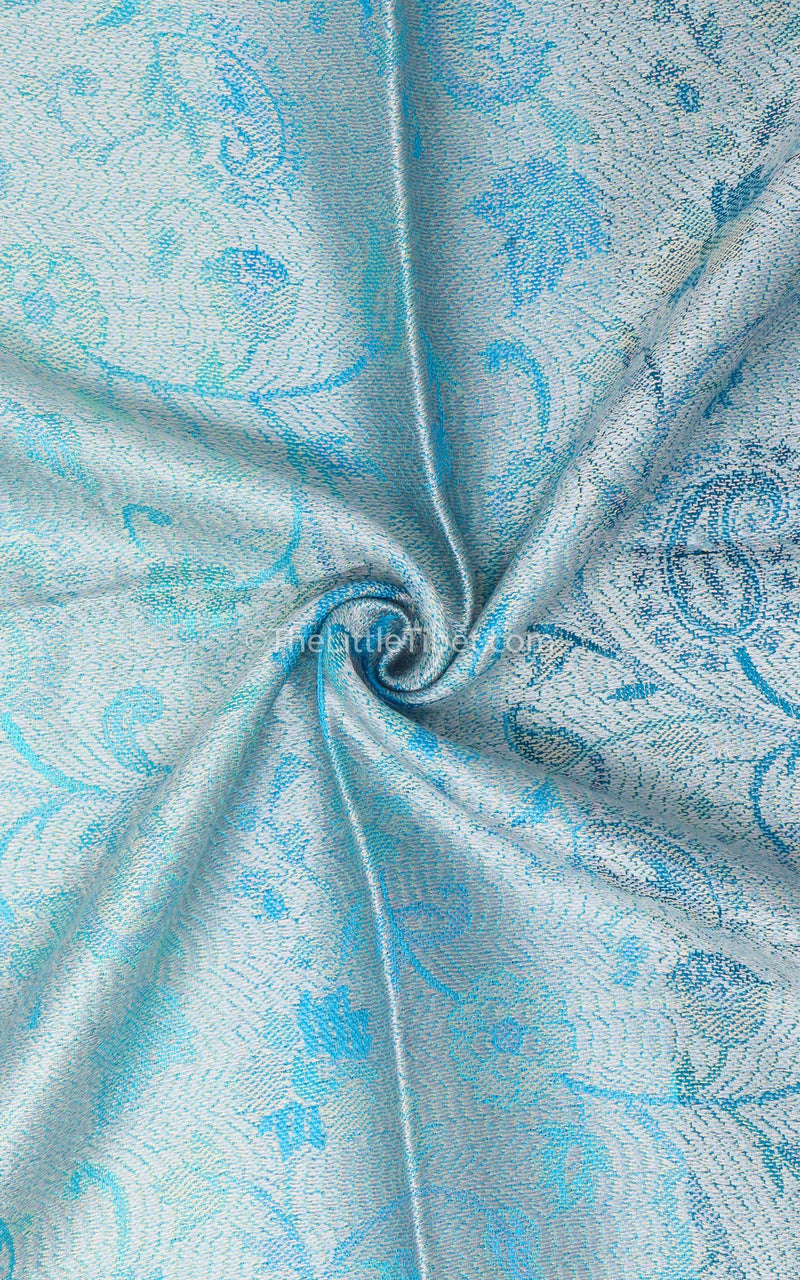 Close up of the reversible Aqua Sea Blue Pure Silk Pashmina with the silver paisley side