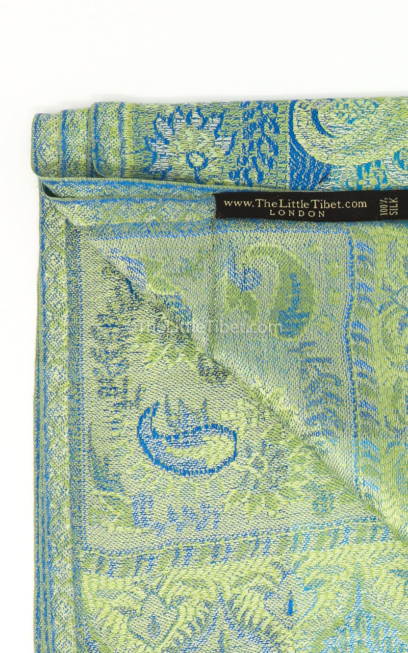 Close up of inside of the Vibrant green pure silk pashmina with blue paisley detail