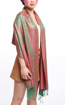 Emerald Green 100% Silk Pashmina silk scarf with orange pink Paisley Design draped around the shoulders