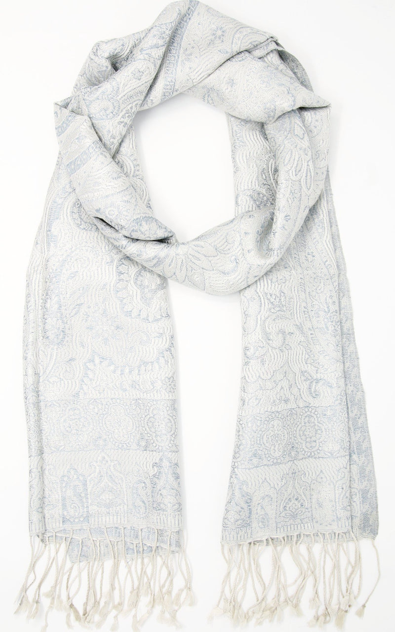 Close up of  stylish white snowy Luxury Silk Pashmina with  paisley detail and tassels