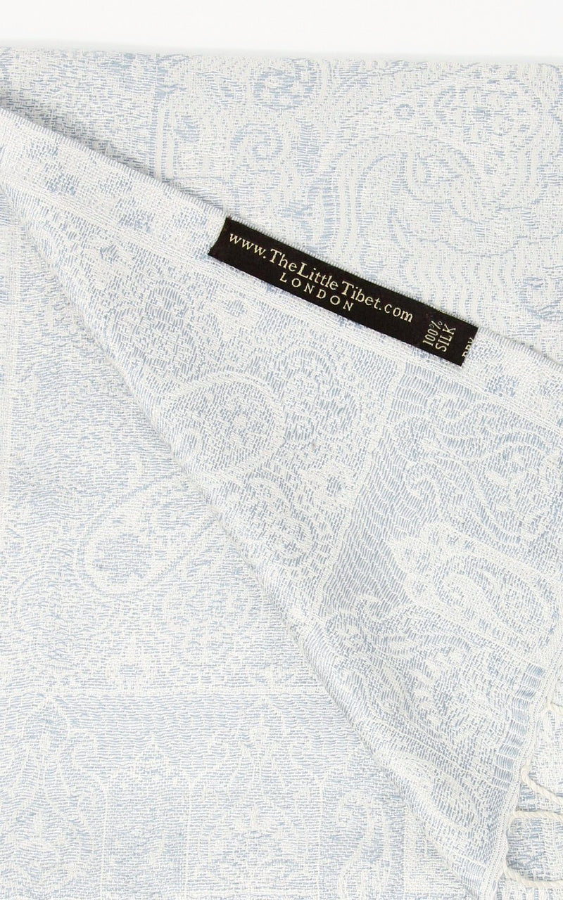 Close up of  inside of the reversible Snowy white  luxury  Silk Pashmina with paisley accents Free Uk Shipping