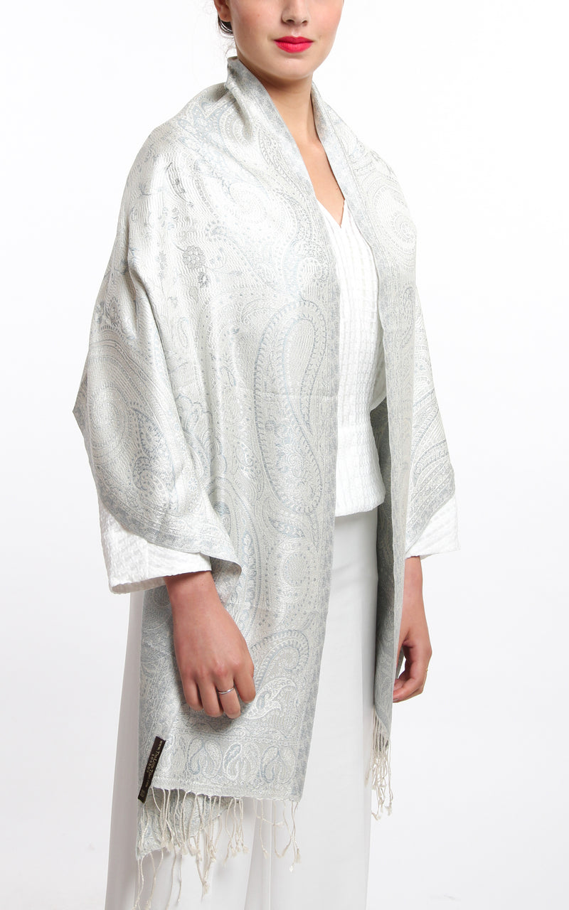 Close up of the white snowy  Pure Silk Pashmina Paisley Design with tassels