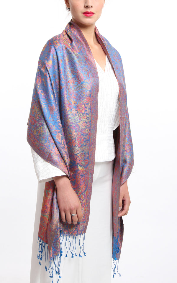 model wearing silk scarf pashmina shawl with floral design in blue silk