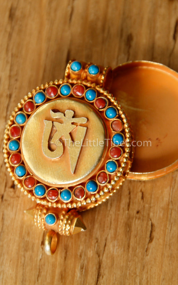 circular Gold Om Locket Pendant turquoise coral detail close up