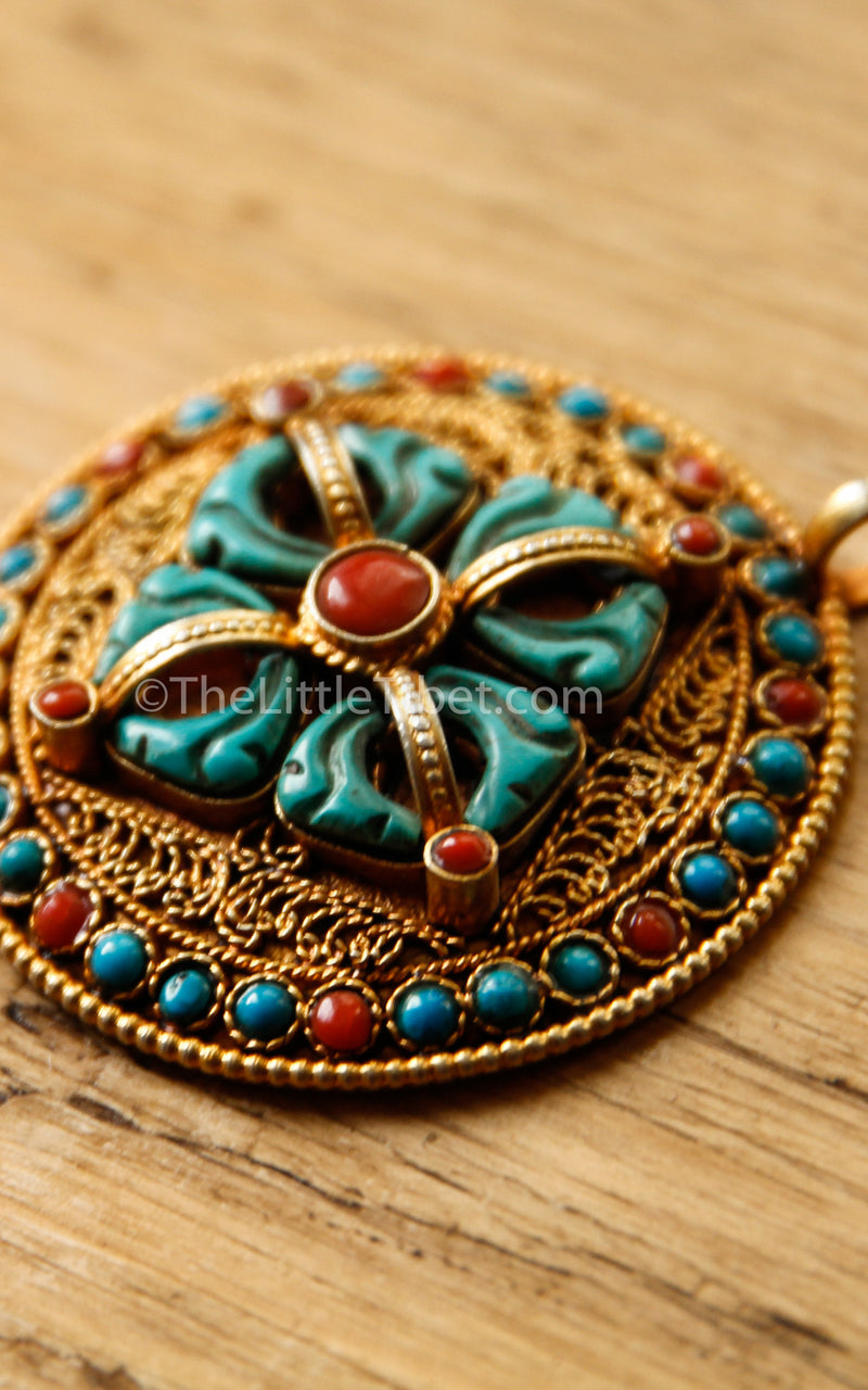 Circular Gold Double Dorjee Pendant turquoise coral accents side view