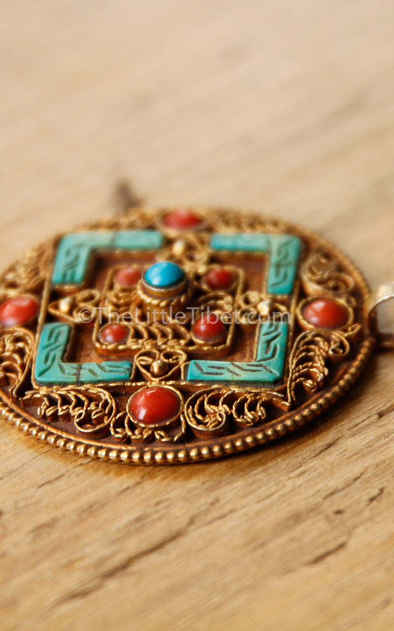circular Mandala Tibetan Pendant with coral turquoise detail close up