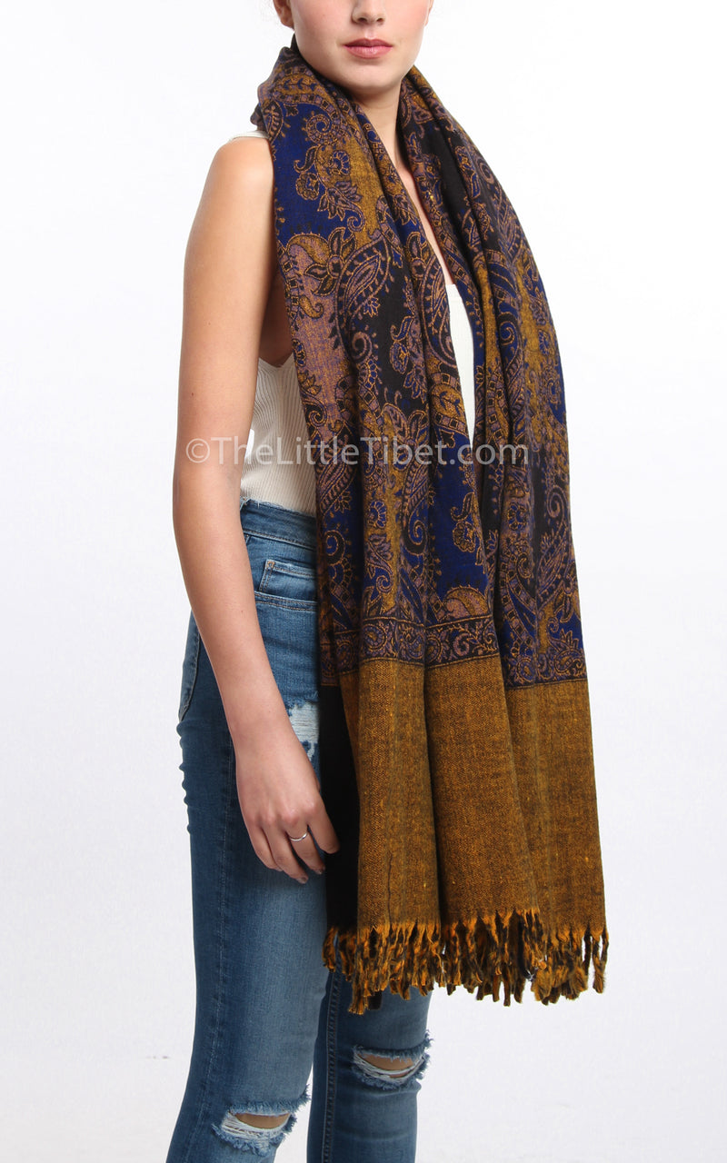 Multi-coloured blue paisley designed blanket scarf tibet shawl around shoulders