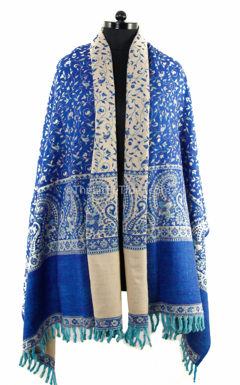 lapis lazuli cream paisley design reversible tibet shawl with tassels  draped around shoulders