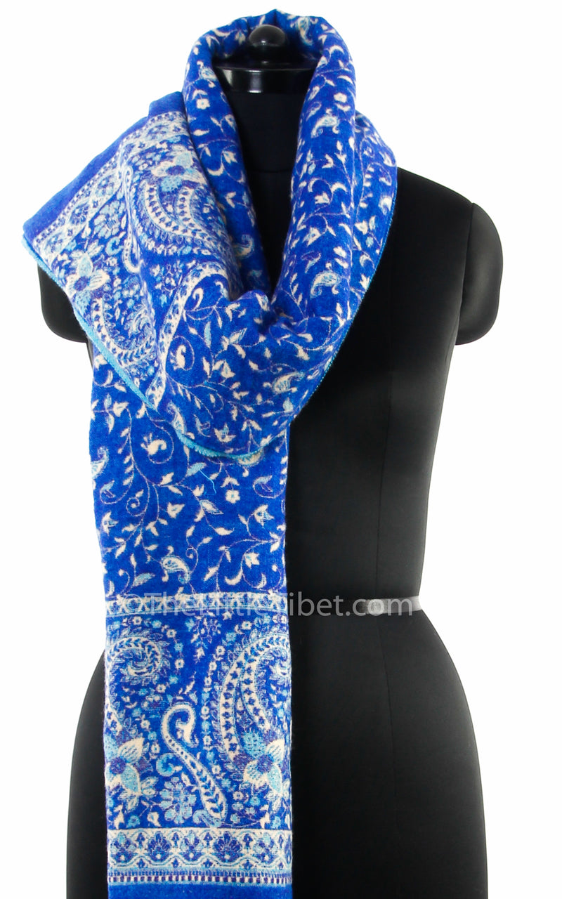 Close up lapis lazuli cream paisley design reversible tibet shawl  with tassels close up