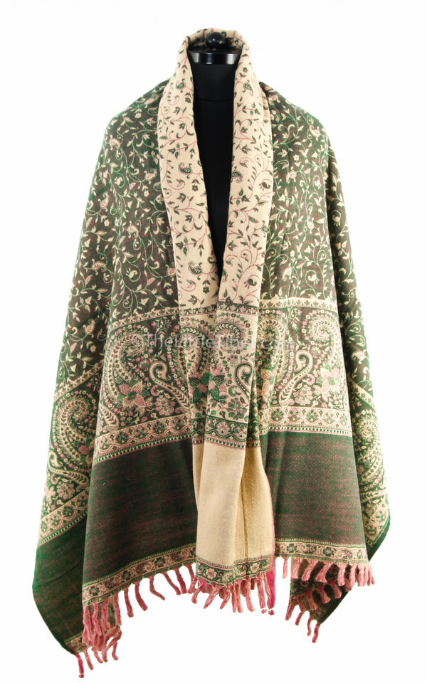 Glade green cream paisley design tibet shawl  with tassels draped around shoulders