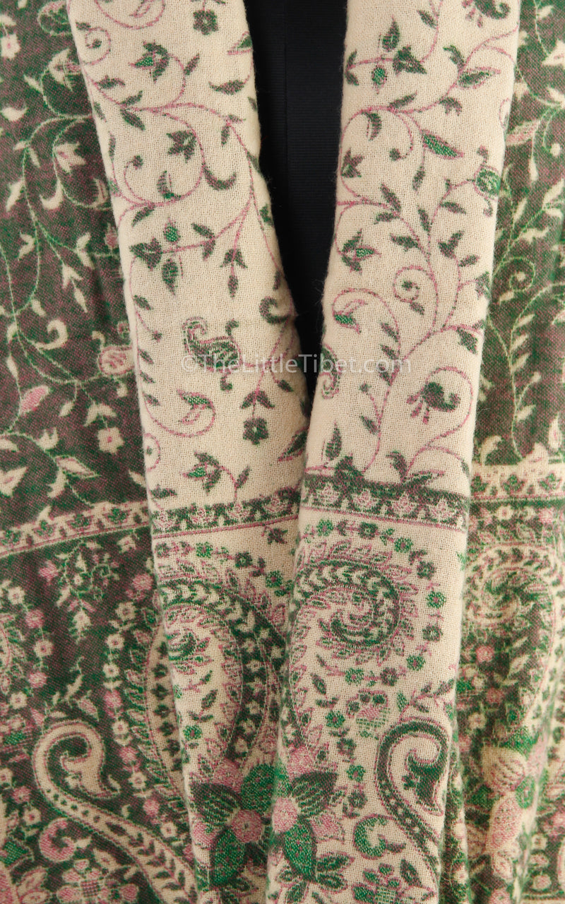 Close up of Glade green cream paisley design tibet shawl  with tassels