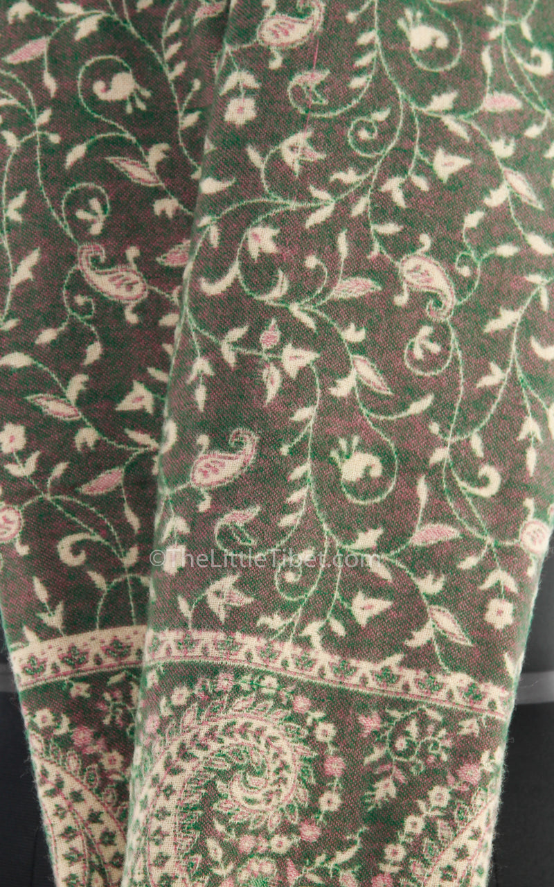 Close up Glade green cream paisley design tibet shawl  with tassels