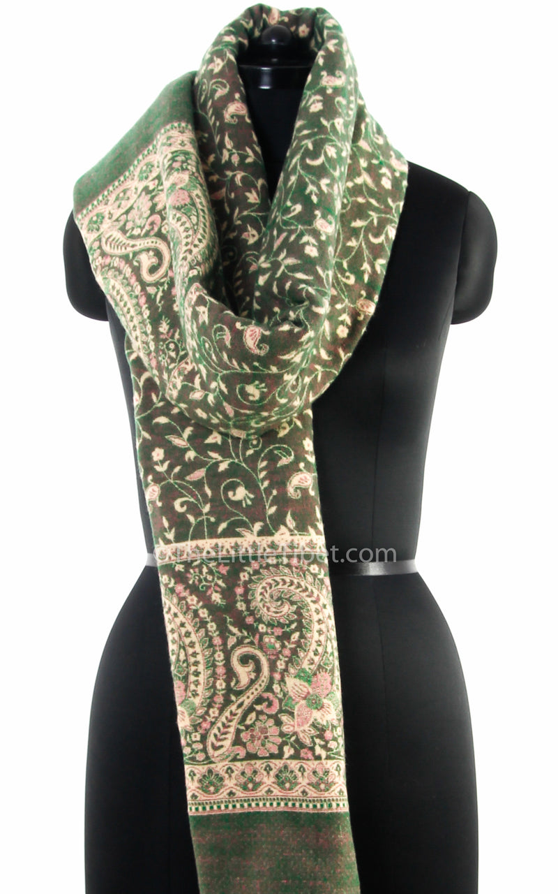 Glade green cream paisley design tibet shawl  with tassels draped around neck