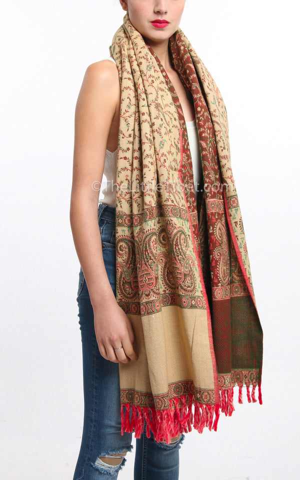 Bronze cream paisley design tibet shawl  with tassels draped around shoulders