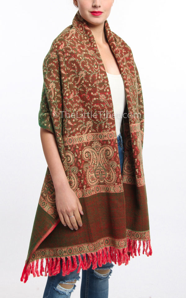 Warm toned brown and cream paisley design tibet shawl blanket scarf draped around shoulders