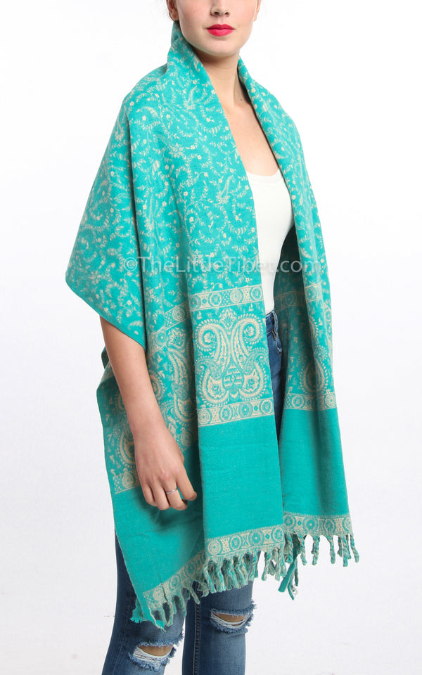 Light Aqua blue cream paisley design tibet shawl chunky knit draped around shoulders