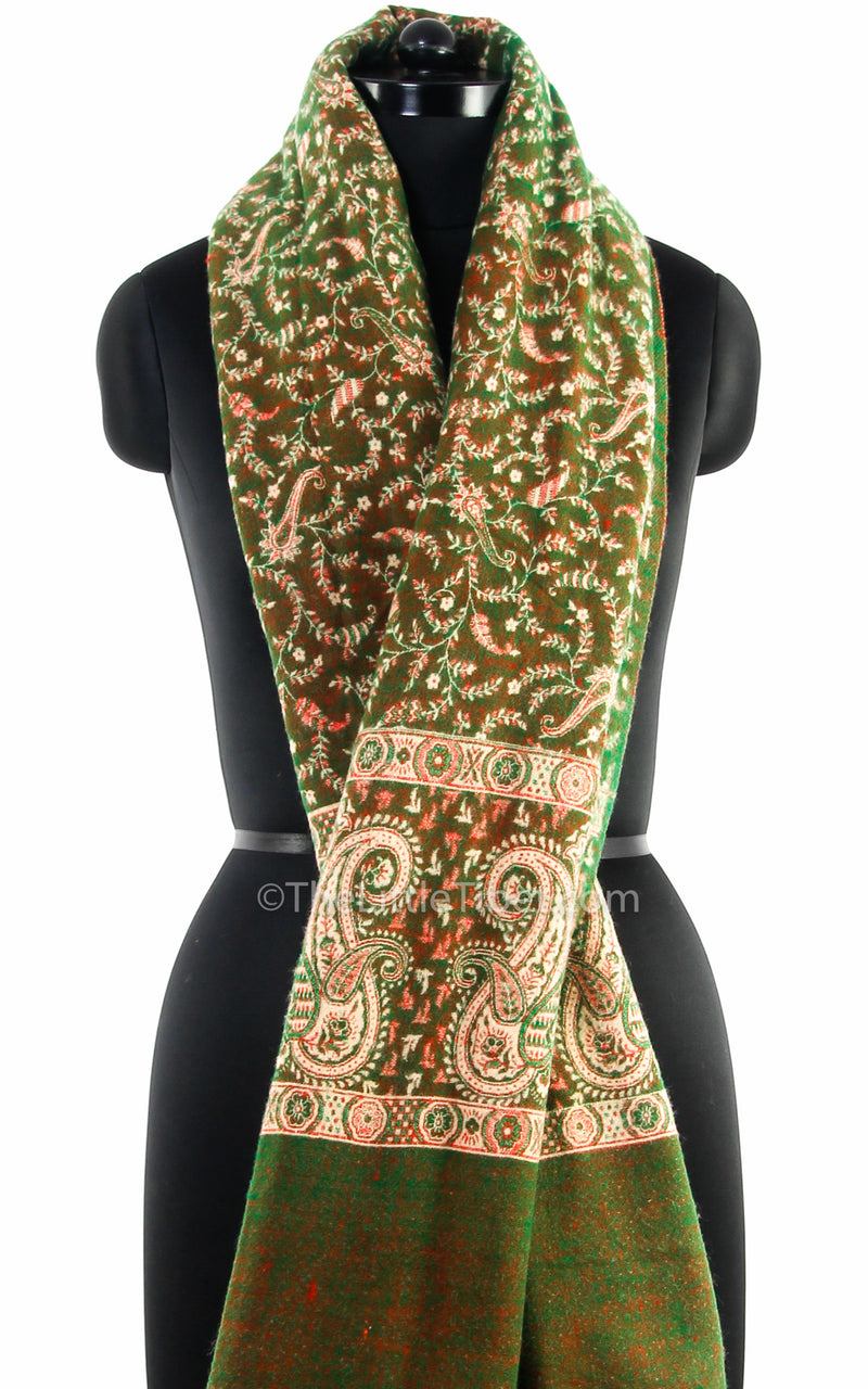 Green cream paisley design tibet shawl  styled around neck