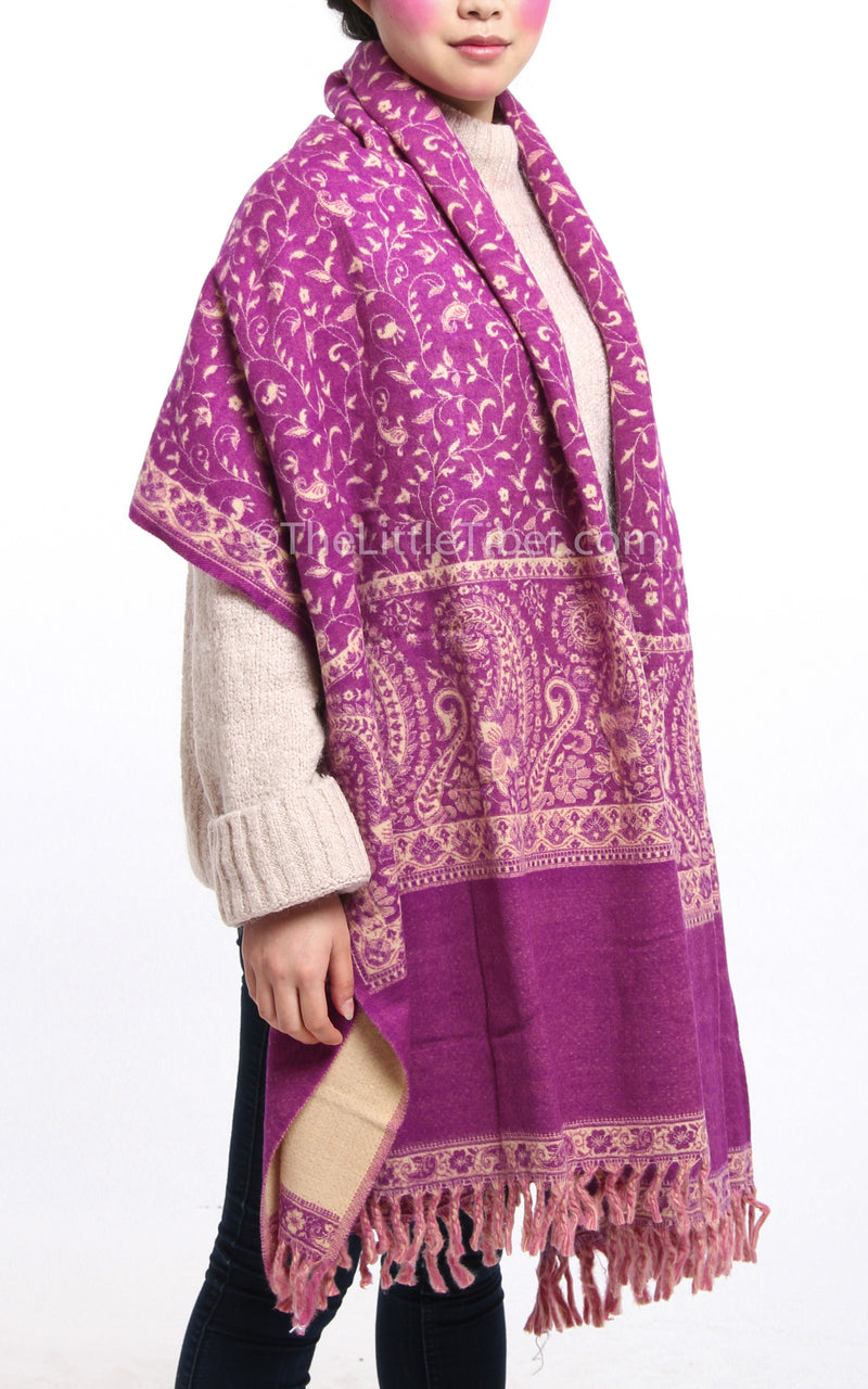Dark Magenta cream paisley design reversible tibet shawl  with tassels  draped around shoulders as wrap