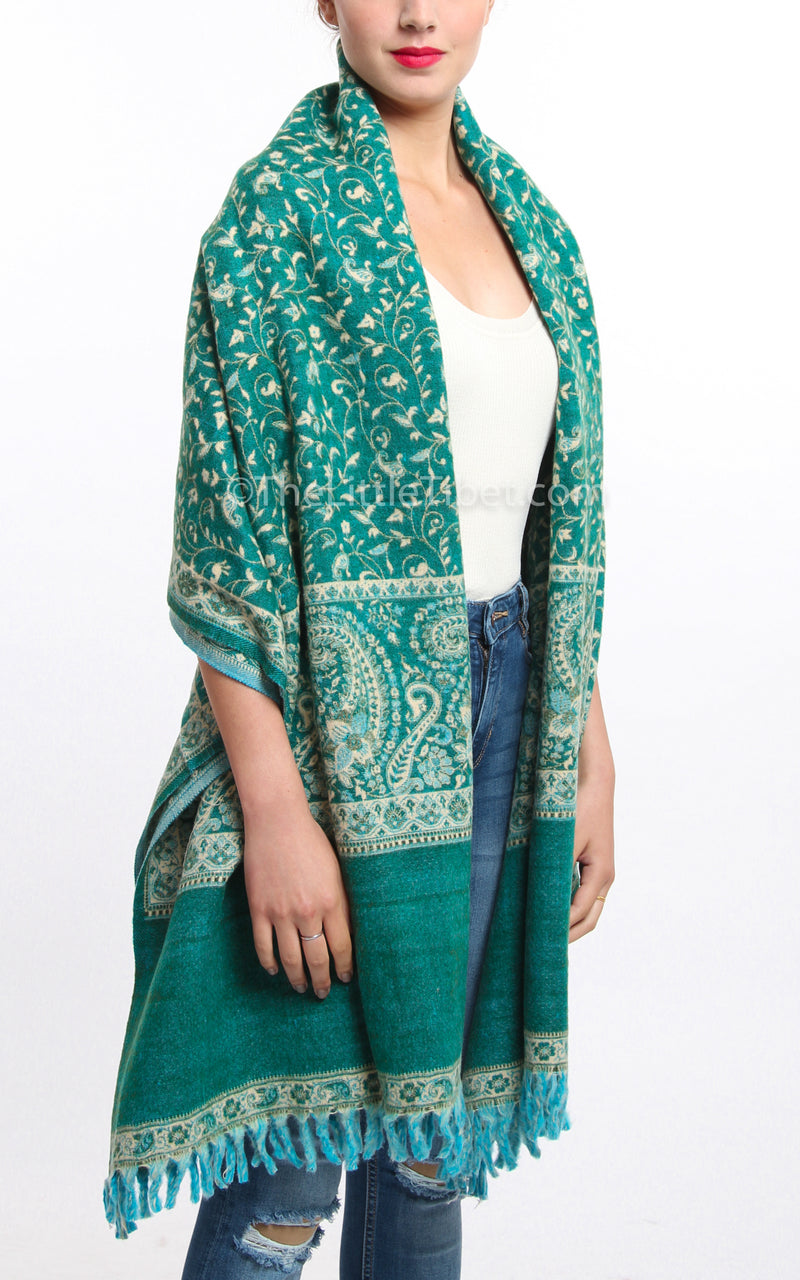 Luxury pine green paisley design tibet shawl draped around shoulders