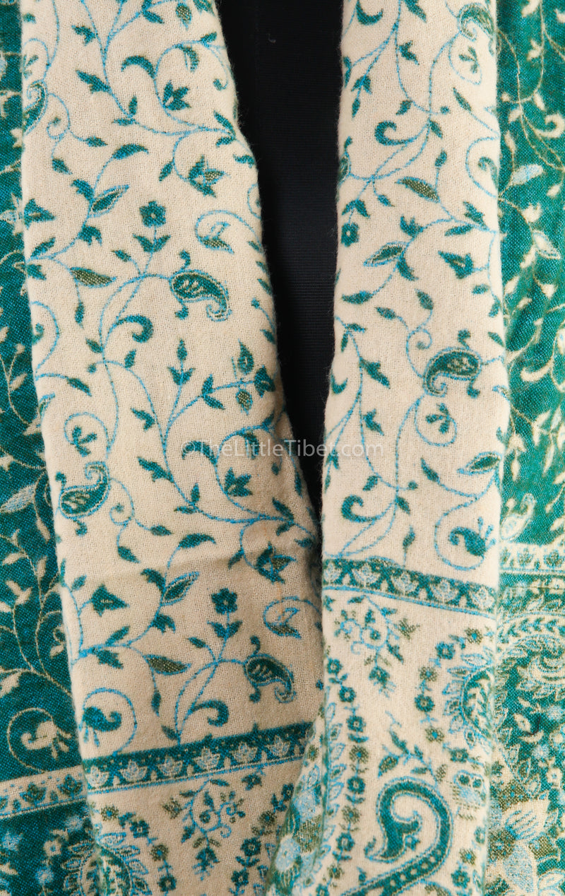 close up Luxury mint dark  green paisley design tibet shawl with reversible cream accents