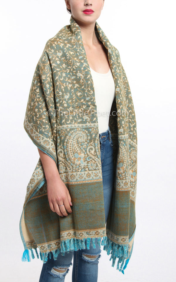 Mild beige lime green paisley design reversible tibet shawl with tassels around shoulders