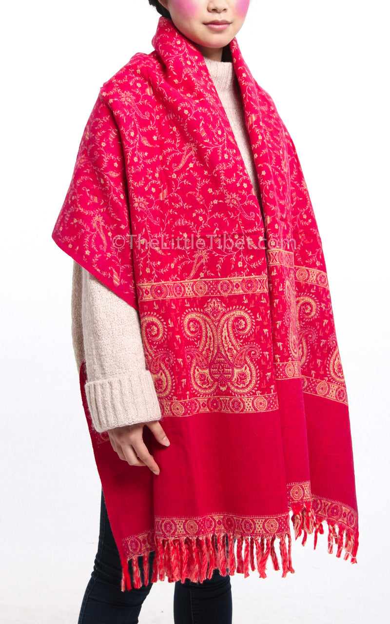 Bright pink paisley design reversible tibet shawl draped around shoulders