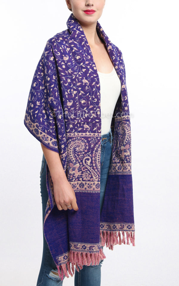 Bright purple cream  paisley design reversible tibet shawl draped around shoulders