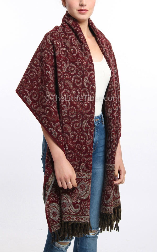 Mahogany  paisley design reversible himalayan tibet shawl draped around shoulders