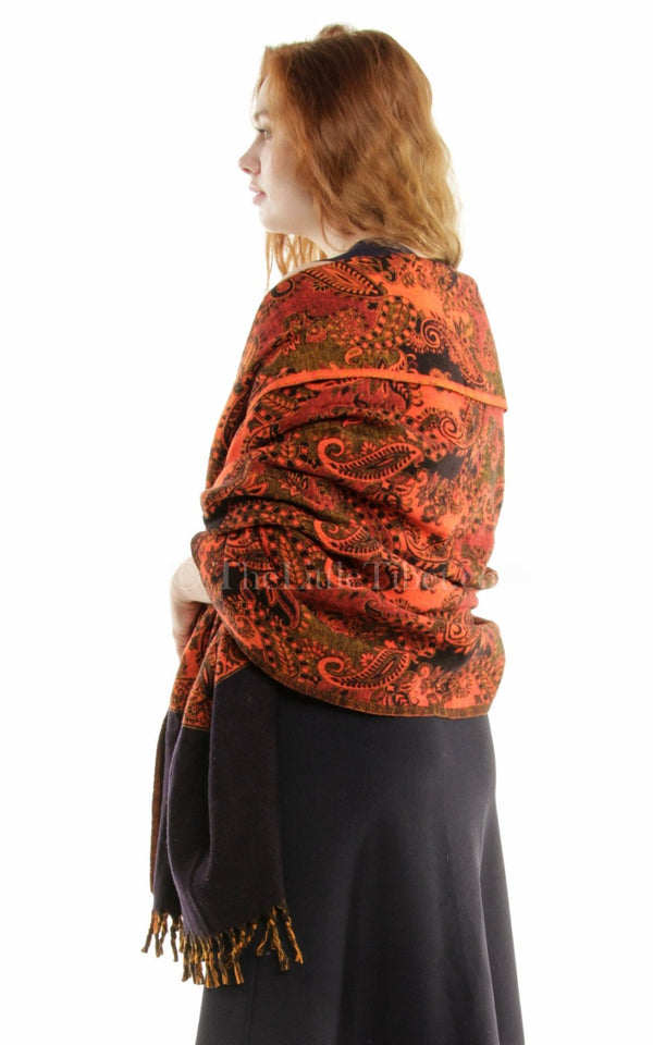 Burnt orange  paisley design reversible himalayan tibet shawl  draped around shoulders