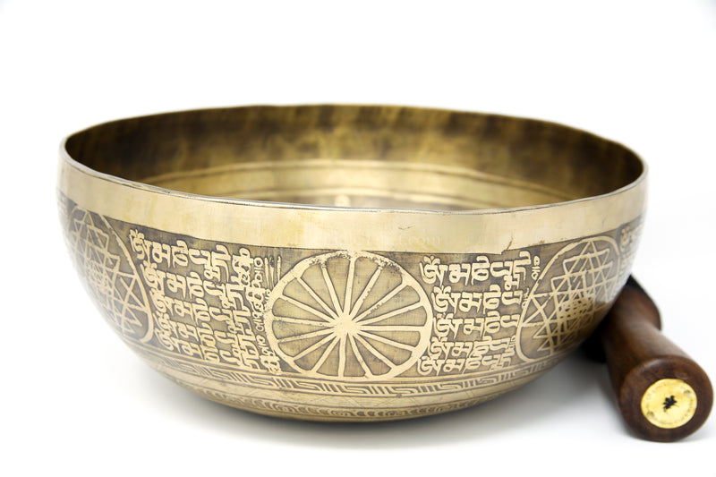 Dorjee thunderbolt etching Hand hammered alloy gold tibetan singing bowl side view