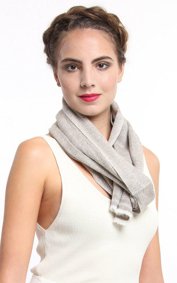 Close up creamy beige with brown pattern detail 100% pure cashmere scarf