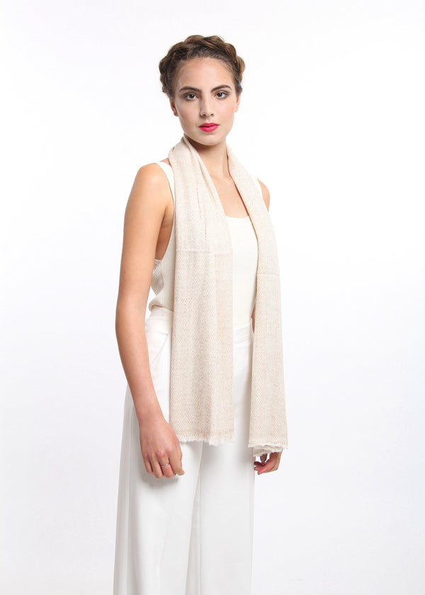 stylish beige skinny 100% pure cashmere scarf draped from shoulders