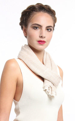 Close up stylish beige skinny  100% pure cashmere scarf wrapped around neck