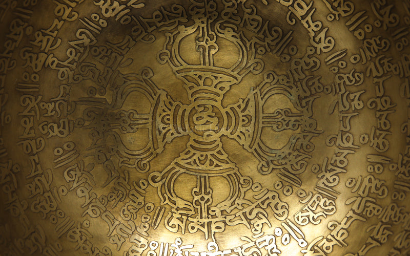Om Mani Pad Me Hum Hand hammered alloy gold tibetan singing bowl meditation close up