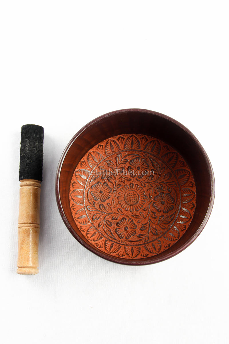 small black aluminium singing bowl sound therapy himalayan instrument orange accents