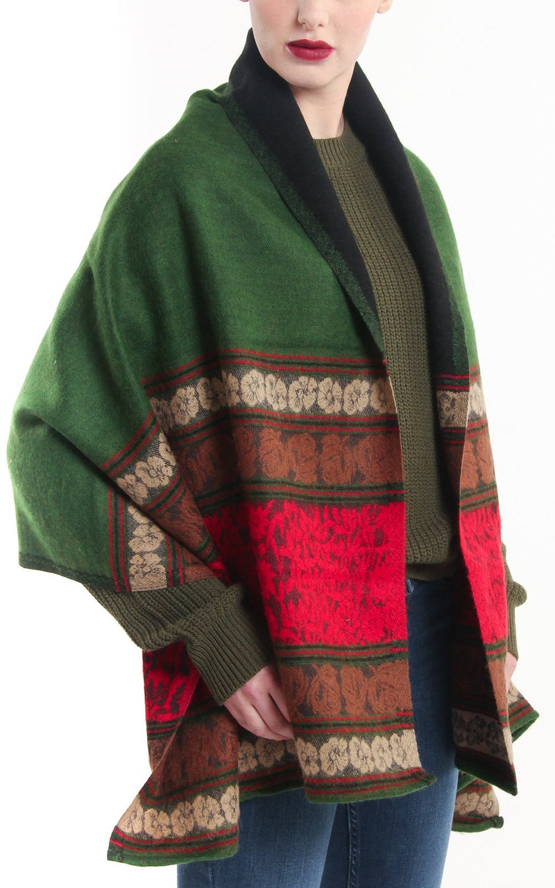 Reversible red green modernistic design with borders tibet shawl draped around shoulders