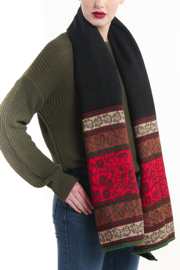 Reversible red green modernistic design with borders tibet shawl draped around neck