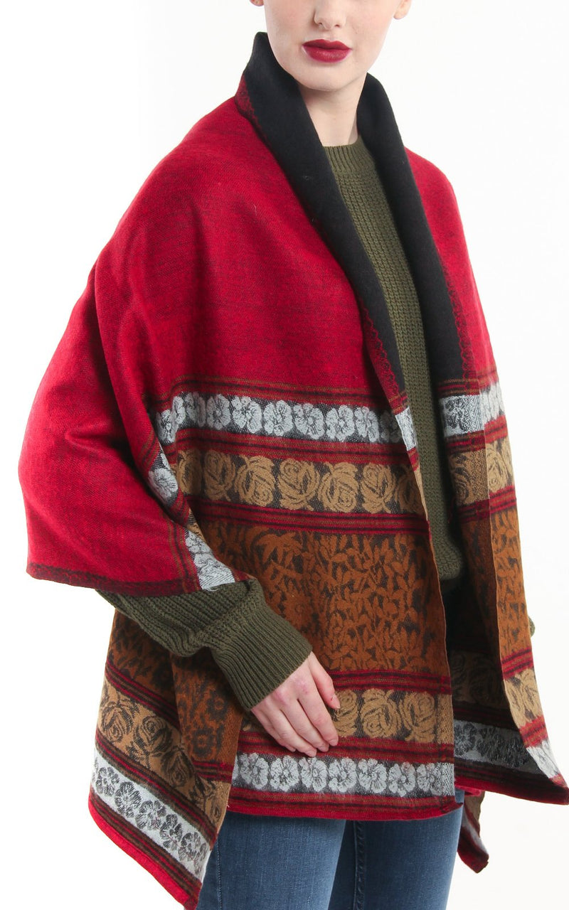 Reversible red green floral patterned with borders tibet shawl styled around shoulders