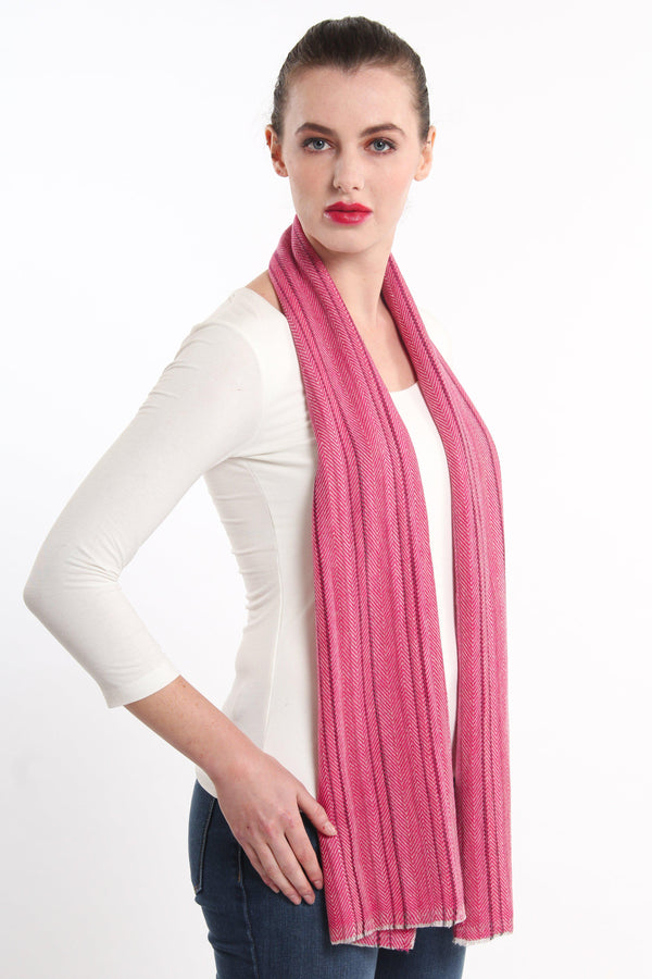 pink stripe detail skinny 100% pure cashmere scarf draped around shoulders