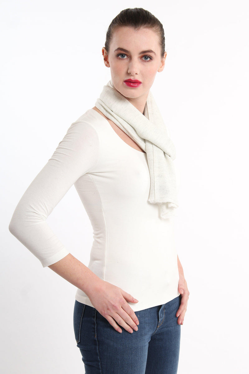 white neutral skinny 100% pure cashmere scarf styled tied around neck