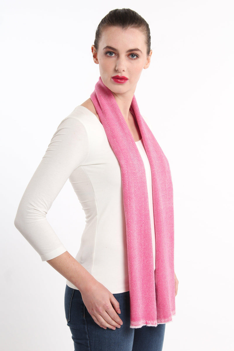 stylish pink  skinny 100% pure cashmere scarf draped around shoulders