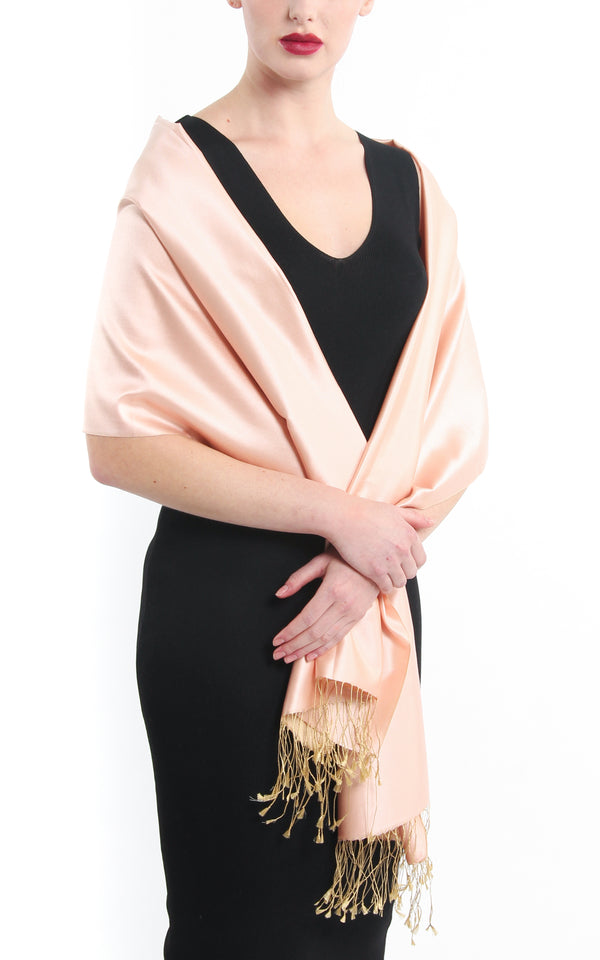 Luxury 100% pure peach plain reversible pashmina shawl draped around shoulders